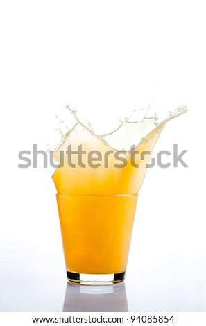 Orange juice splash on white background - stock photo