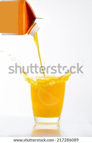 Orange juice splash prepare for breakfast in the morning - stock photo