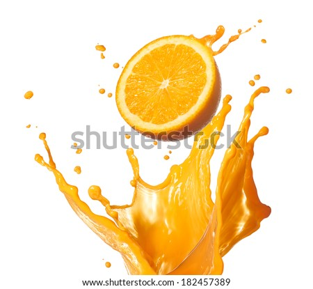 orange juice splashing with its fruit isolated on white - stock photo