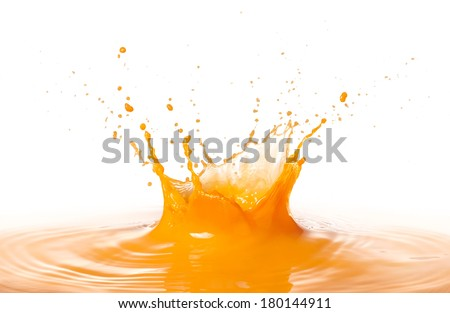 orange juice splashing with ripple against white background - stock photo