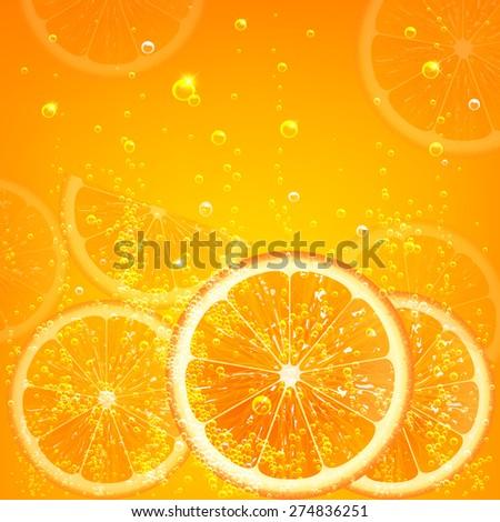 orange juice with orange slices and bubbles - stock photo