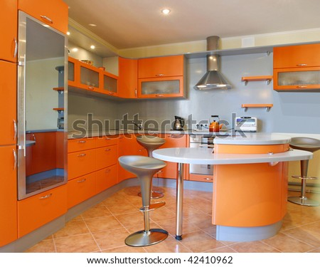 orange kitchen interior - stock photo