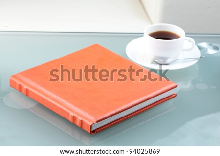 orange leather book on bright background - stock photo