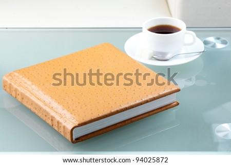 orange leather book on bright background - stock photo