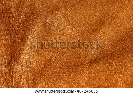 Orange leather texture. Background and texture for design. - stock photo