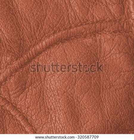 orange leather texture closeup, seams