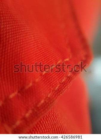 Orange leather texture with seam closeup. - stock photo