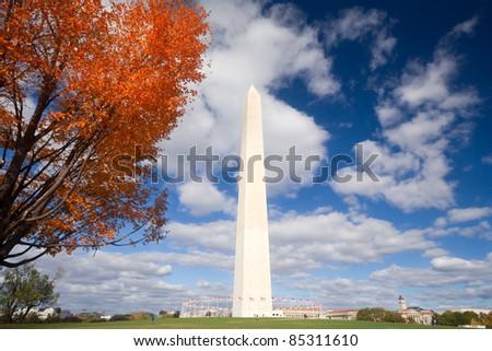 Orange leaves and blue sky surround the Washington Monument in Washington, DC, USA - stock photo