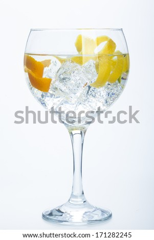 orange lemon and lime gin tonic isolated over white background