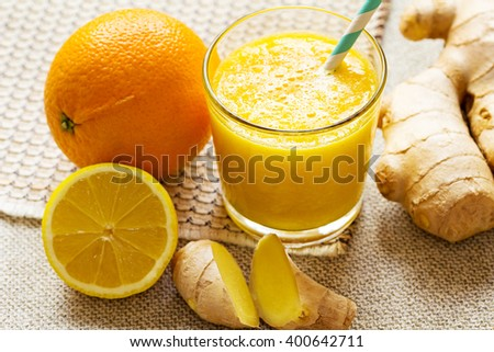 Orange, lemon, ginger smoothies. Vegan energy smoothie. - stock photo