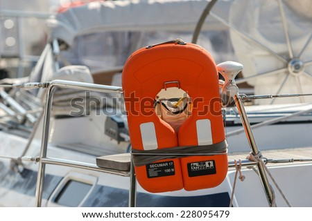 orange life jacket on a boat - stock photo
