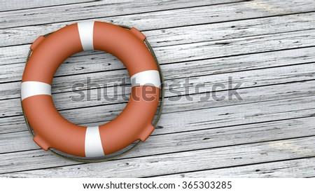 Orange Lifebuoy on wood background  - stock photo