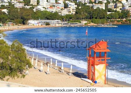 Orange lifeguard tower on a sandy beach near Athens, Greece - stock photo