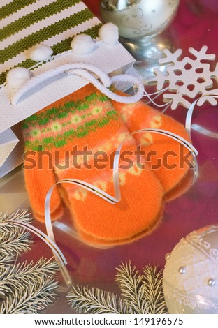 Orange little baby mittens - stock photo
