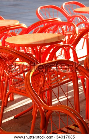 Orange metal cafe table and chairs