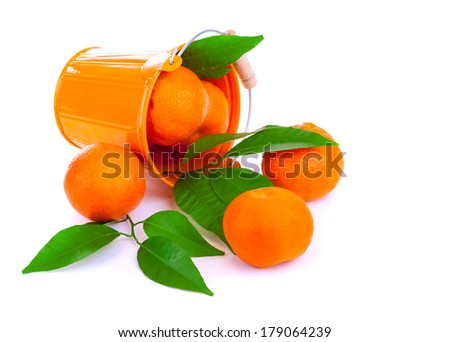 Orange metallic bucket with fresh mandarins fall down, tasty ripe citrus scattered on white background, tropical fruits full of vitamins - stock photo