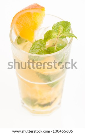 Orange Mojito close up, a Cuban cocktail made from  cuban rum, lime, sugar, a splash of soda and flavoured with fresh orange juice - stock photo