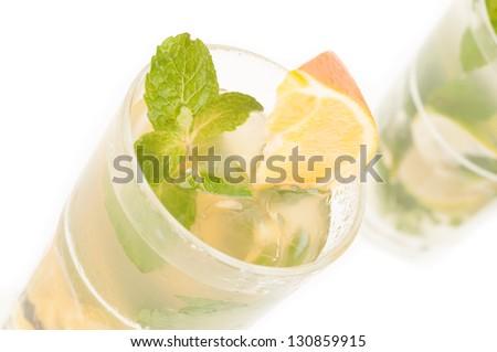 Orange Mojito cocktail top view close up - stock photo