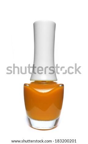 orange nail polish bottle on white background - stock photo