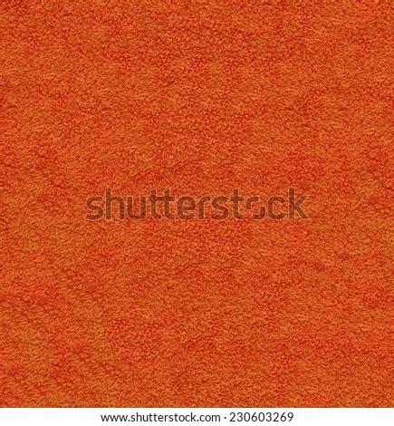 Orange natural plush terry cloth turkish bath / beach bathroom towel, textured fabric macro background closeup texture - stock photo
