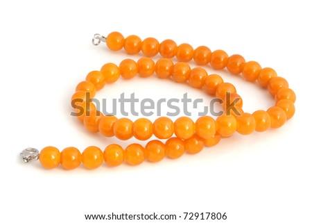 Orange necklace on a white background - stock photo