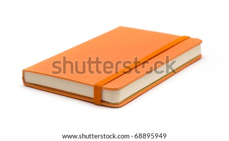 Orange note book.  Look through my portfolio to find more images of the same series - stock photo