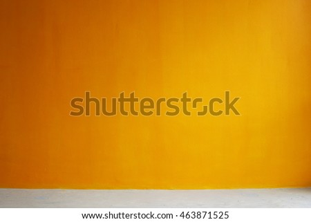 orange painted wall with concrete floor, interior background