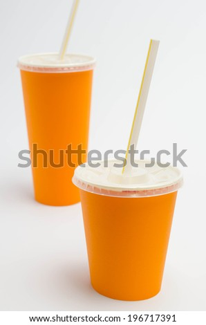 Orange paper cup  on white background - stock photo