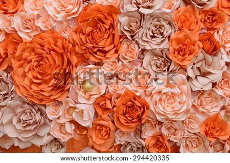 orange paper flower backdrop  - stock photo