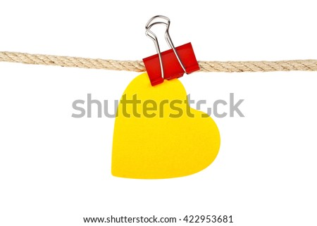 Orange paper in shape of heart on a rope isolated on white background - stock photo