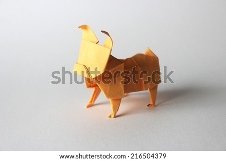 Orange paper origami pug isolated on white background - stock photo