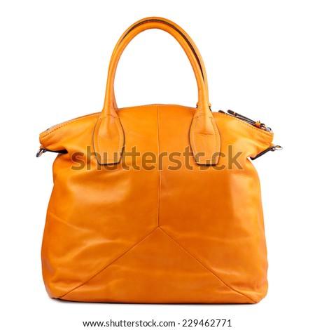 Orange patent handbag isolated on white background. - stock photo