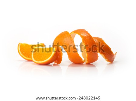 Orange peel and orange wedge on white background