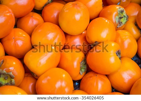Orange persimmon kaki fruits freshly - stock photo