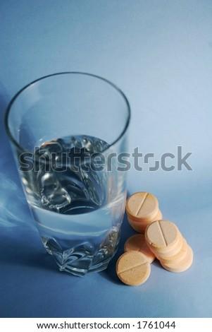 orange pills and water - stock photo