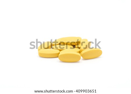 Orange pills on white background.isolate