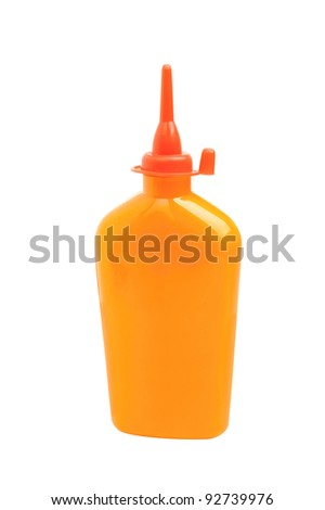 Orange plastic bottle with red nozzle isolated on white background