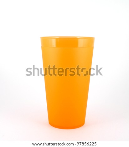 Orange plastic cup over white