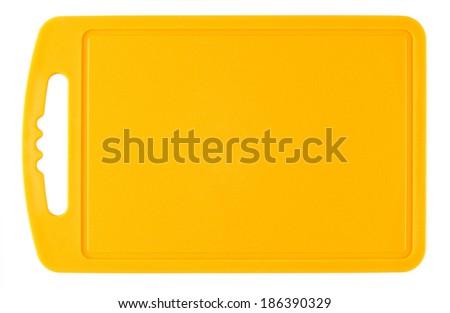 Orange plastic cutting board isolated on white background - stock photo