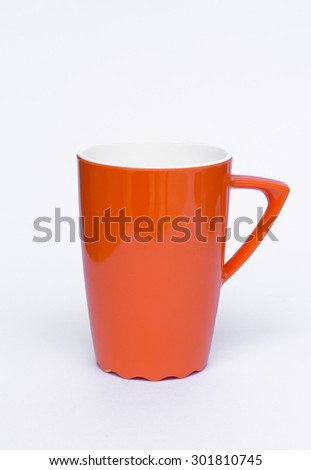 orange plastic glass on white background - stock photo