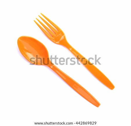 orange plastic spoon and fork isolated on white background - stock photo