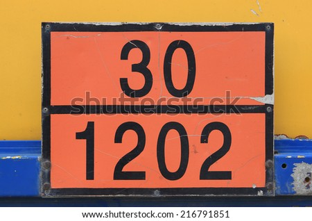 Orange plate with hazard identification number, sometimes called the Kemler code. Vehicles with tanks carry the HIN (hazard identification number) to identify the risk of products being transported. - stock photo
