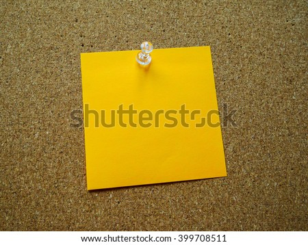 Orange post it  on wooden board - stock photo