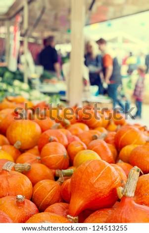 Orange pumkins at the market - stock photo