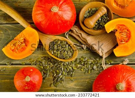 Orange  Pumpkins  on a wooden background. Selective focus - stock photo