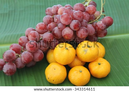 Orange, purple grapes