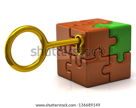 Orange puzzle cube with golden key - stock photo