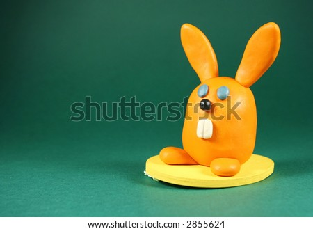 Orange rabbit on green. Made from plasticine