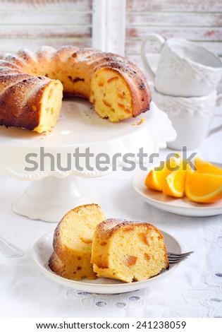 Orange ring cake with icing sugar - stock photo