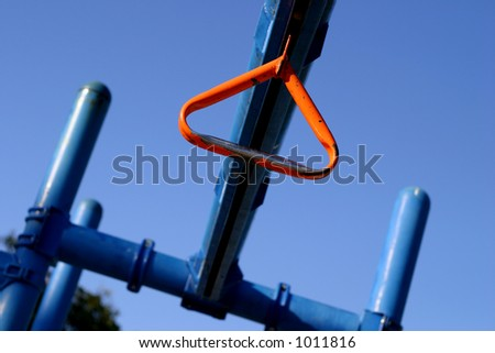 Orange ring in jungle gym - stock photo
